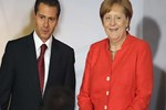 Merkel'den İran ve Türkiye'ye Katar çağrısı