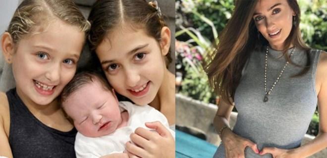 Pınar Tezcan üçüncü kızını kucağına aldı