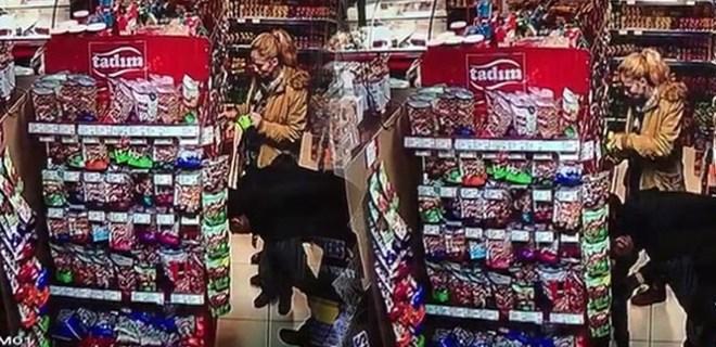 Çocuklarının gözü önünde marketi talan ettiler!